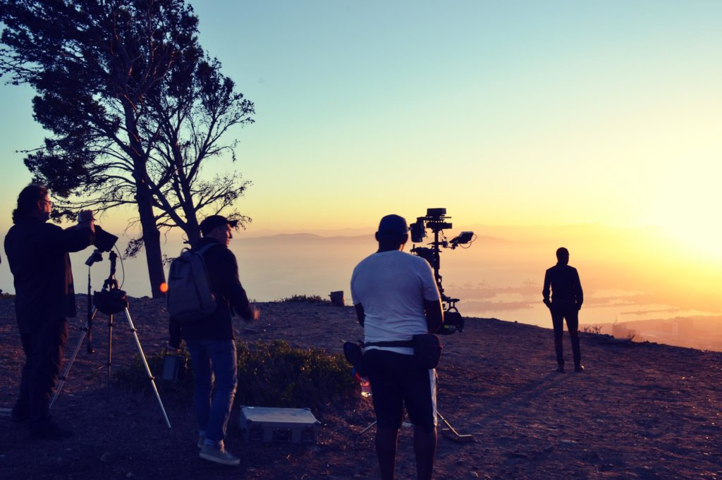 Silhouetted film crew at lookout point in South Africa, shooting Inmarsat 40th Anniversary communications film