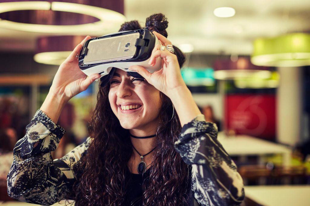 Smiling woman after virtual reality presentation at Vodafone Digital Telco