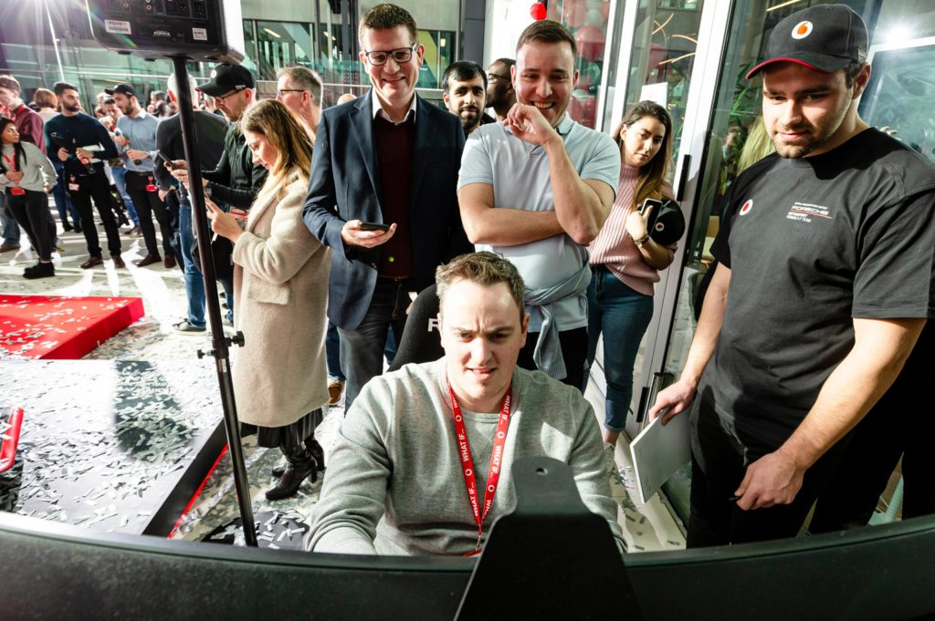 Guests try brand simulation at Vodafone and Porsche Formular E brand launch event