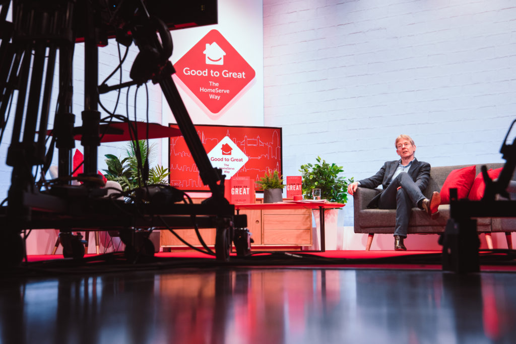 Speaker addresses remote audience down the camera at leaders conference