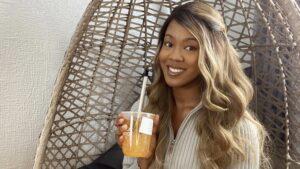 Clarissa Jean-Jacques smiling holding bubble tea